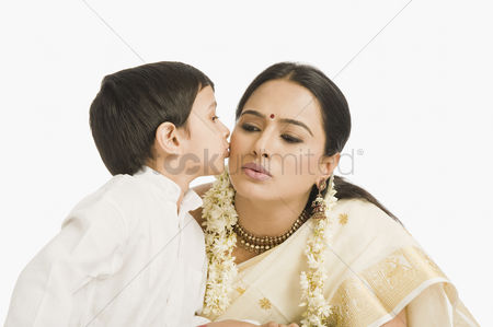 Kissing : Boy kissing his mother