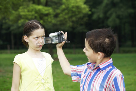 Funny : Boy recording images of girl making a face