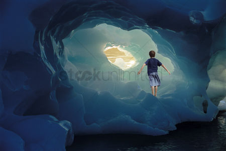 Young boy : Boy standing on iceberg