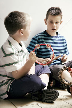Children playing : Boys playing with musical instrument