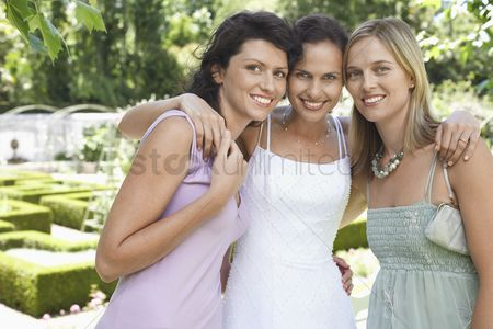 Posed : Bride and bridesmaids in garden