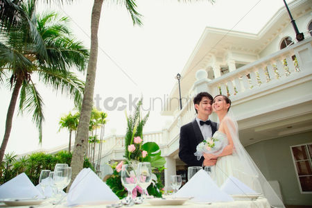 Asian : Bride and groom at their wedding reception