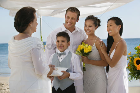 Pre teen : Bride and groom with family at beach wedding