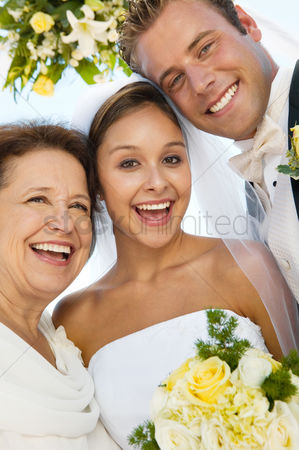 Senior women : Bride and groom with mother outdoors  close-up   portrait