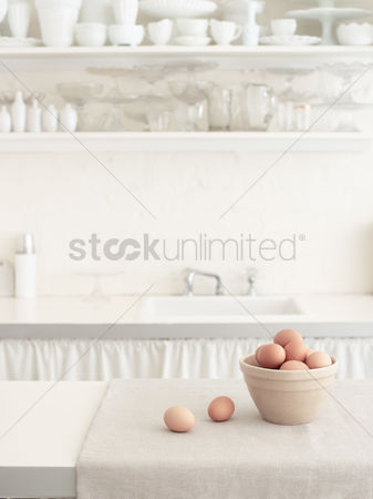 Bowl : Brown eggs in bowl in white kitchen