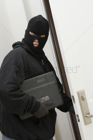 Thief : Burglar stealing laptop