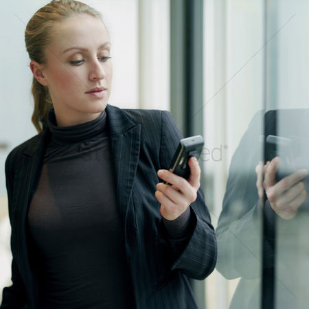 Accessibility : Business lady using cell phone