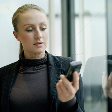 Adulthood : Business lady using cell phone