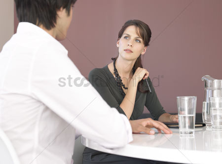 Interior background : Business man and woman having meeting