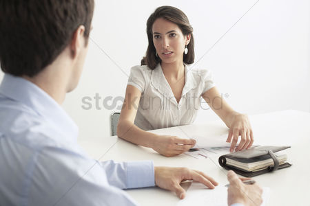 Two people : Business man and woman in meeting