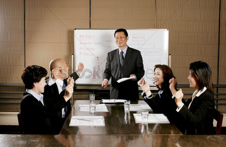 Business suit : Business man and women rejoicing their success