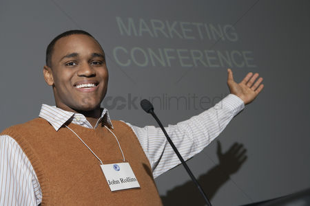 Motivation business : Business man giving presentation at conference meeting portrait