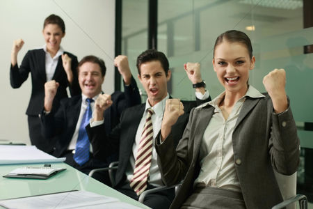 Business suit : Business people celebrating their success