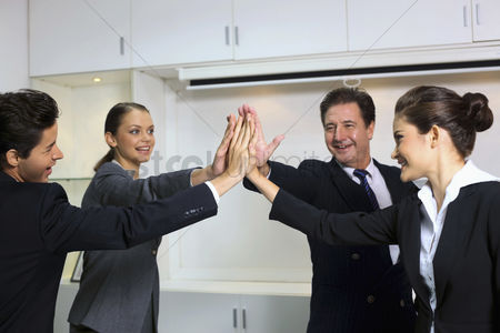 Leadership : Business people giving high-five at board room