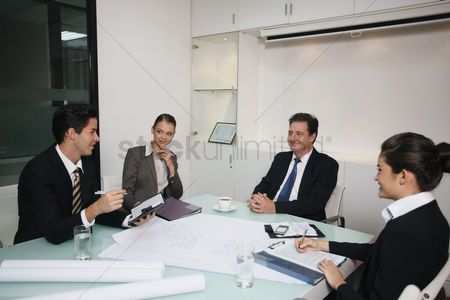 40 44 years : Business people having discussion in conference room