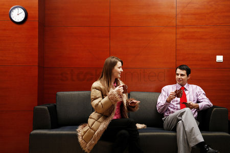 Attraction : Business people talking while drinking coffee