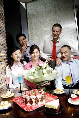 Birthday present : Business people throwing a surprise birthday party for their female colleague