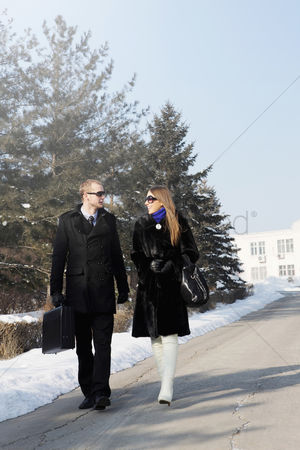 On the road : Business people walking together on winter day