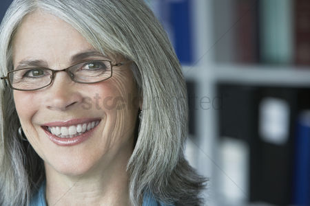 Mature : Business woman in office portrait close up