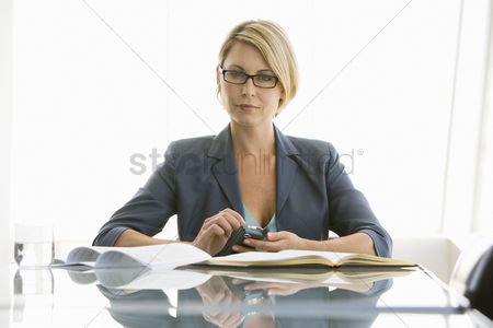 Posed : Business woman working in conference room portrait