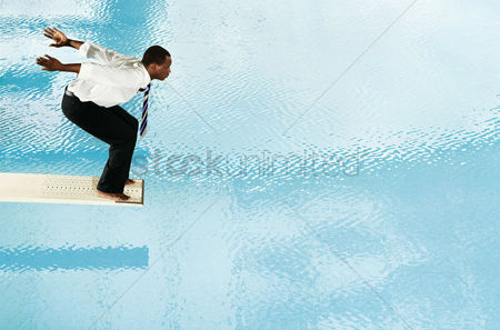 Diving : Businessman about to jump off the diving board