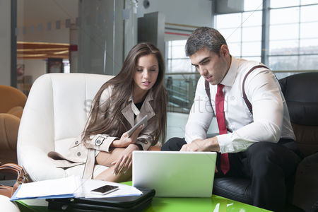 Czech republic : Businessman and businesswoman at meeting with laptop