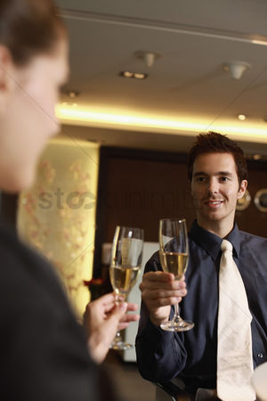 Toasting : Businessman and businesswoman toasting drinks