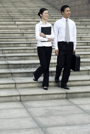 Staircase : Businessman and businesswoman walking together