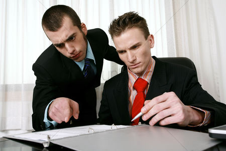 Careful : Businessman and his assistant reading through a contract