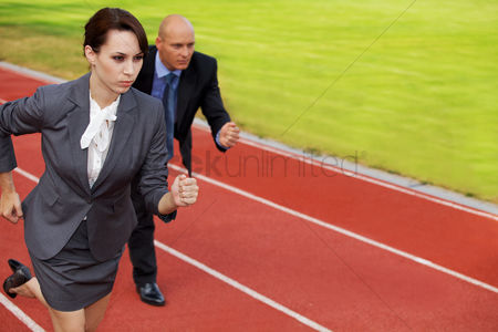 Bald : Businessman and woman on running on race track