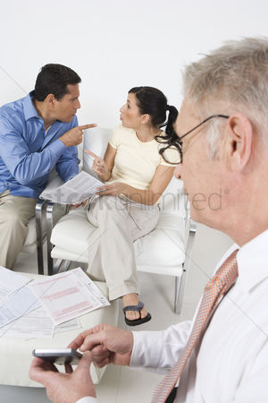 Senior women : Businessman assisting angry couple