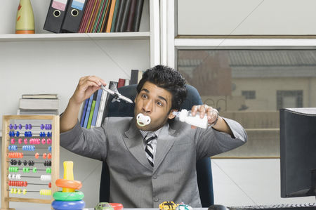Thermometer : Businessman behaving like a kid in an office