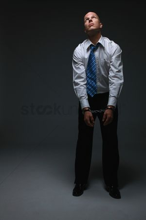 Forbidden : Businessman being handcuffed