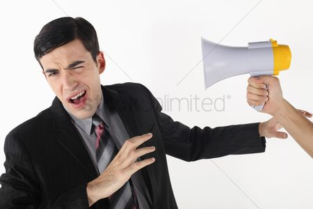 Motivation business : Businessman being shouted at through a megaphone