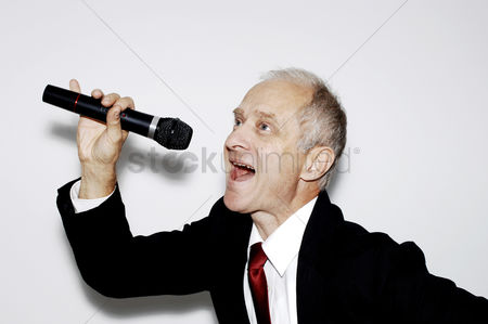 Having fun : Businessman belting out a song