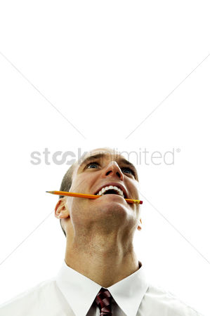 Fury : Businessman biting a pencil while thinking