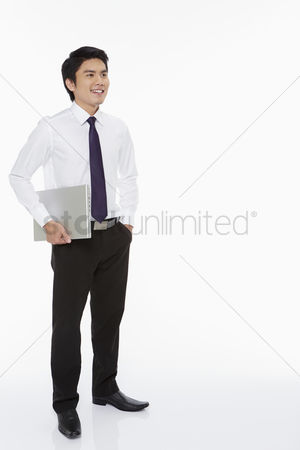 Portability : Businessman carrying a laptop