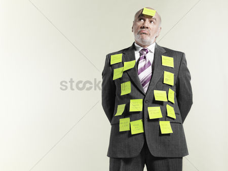 Office worker : Businessman covered with sticky notes