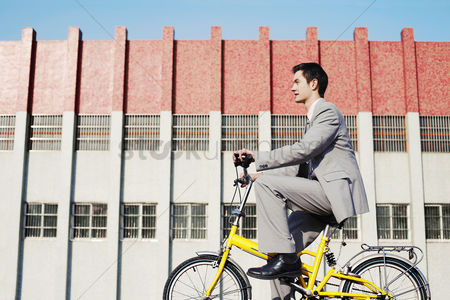 Determined : Businessman cycling to work