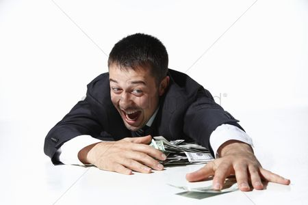 Satisfaction : Businessman gathering all the money on floor