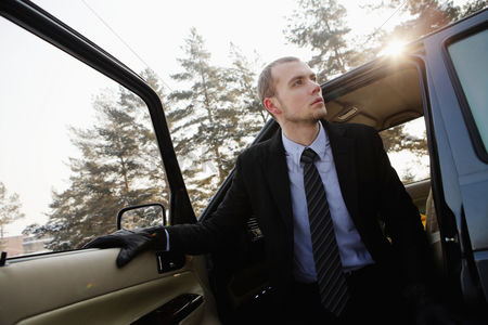 Cold temperature : Businessman getting out of the car