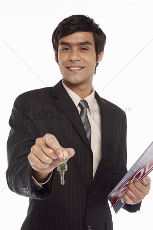 Sets : Businessman handing out a set of keys