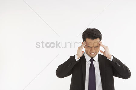 Masculinity : Businessman having a headache