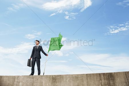 Respect : Businessman holding a green flag