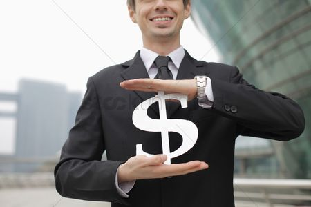 Cardboard cutout : Businessman holding dollar sign