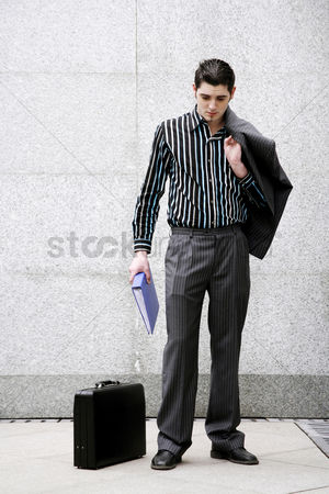 Loss : Businessman holding his coat and a document