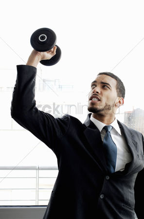 Satisfaction : Businessman lifting dumbbell