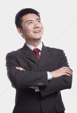 Proud : Businessman looking up