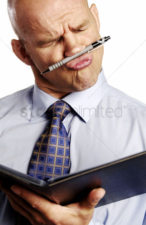 Bald : Businessman making funny facial expression while reading document