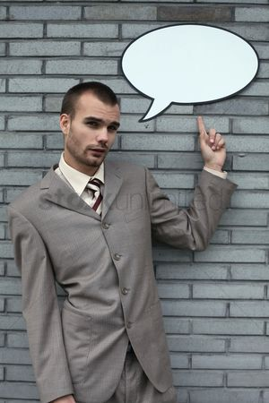 Cardboard cutout : Businessman pointing at speech bubble